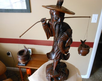 Tall Seven Piece Hand Carved Chinese Fisherman