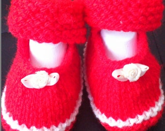 very nice in red knitted baby shoes for little princesses