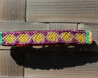 Green, purple and yellow string knotted barrette