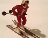 Barclay Antique Lead Female Skier with Skis and Poles