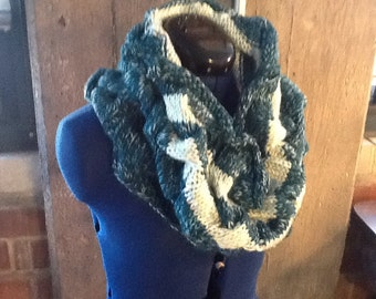Teal cable knit cowl.