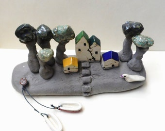 Ceramics and pottery handmade sculpture , ceramic sculpture of an island with miniature houses and boats / rustic / beach / one of a kind