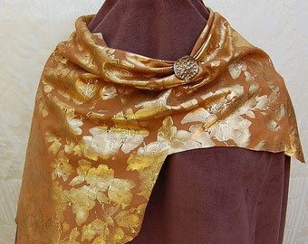 Leather scarf, with gold foil flowers and single antique gold button inlaid with crystals.
