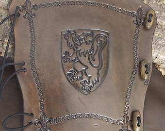 Lion, embossed leather Archers bracer, Archery bow arm guard, Antique dyed. Choose your colour.