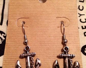 Silver anchor dangles