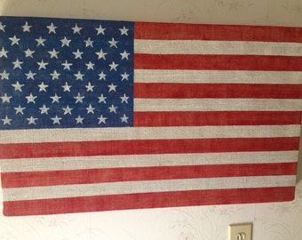 American Flag made from wood wrapped in burlap painted red white and blue