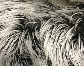 Gray/silver frost Mongolian fake fur.3 inch pile.36x60 inches. Sold by the yard.