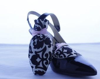 Creme and black damask shoe sachet.