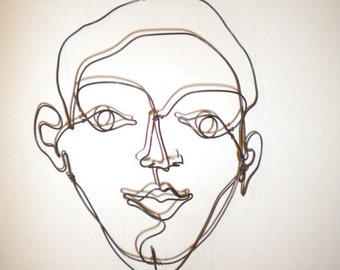 Boy's face--3-D steel wire sculpture