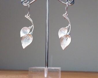 Matte silver calla leaf earrings