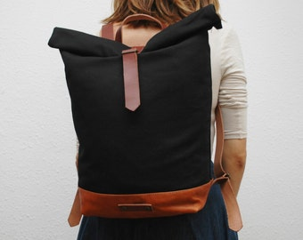 Waxed Canvas rucksack/backpack,black color,with handles, leather base, and closures