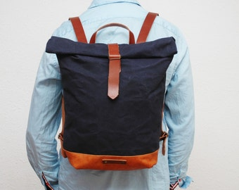 waxed Canvas rucksack/backpack, navy color, hand waxed , with handles, leather base  and closures