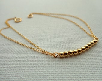 Gold Bracelet filled 14 k with mini beads, simple, modern, minimal, delicate, done in hands, minimalist