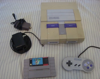 Super Nintendo Console with controller and Super mario world