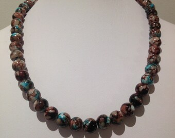 Necklace. 48cm. Features 10mm round Glass beads. Blue/brown with mottled effect.