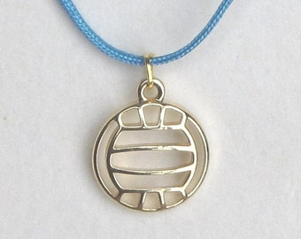 Volleyball necklace with gold metal pendant on nylon cord