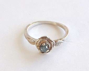 Blue Diamond Ring With Dainty Rose Detail