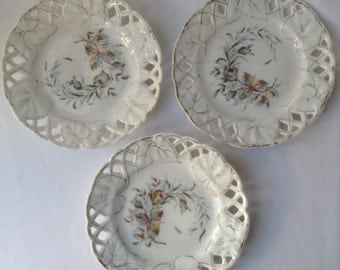 Three hand painted vintage plates