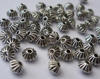 50 Silver Tone Bicone Spacer Beads 4mm BD29