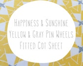 Fitted cot sheet. Yellow and Gray Sunshine Pin wheels. Ready made. Modern fitted cot crib sheet by Avie and Mabel, Australia