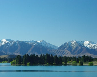 The majesty of New Zealand's Southern Alps in the background and the serenity of the lake in front. make for an image of great beauty.