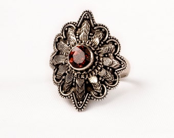 Stunning Vintage Silver  Ring with a fine Garnet Gem .    Unique design.