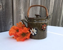 Vintage Green Teapot with Wicker Handle and Orange and White Flowers