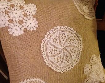 Burlap pillow with antique doily detail