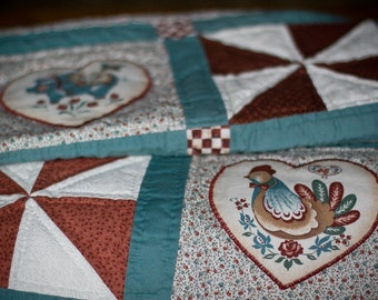 Pinwheel Baby Quilt with Appliqued Hearts