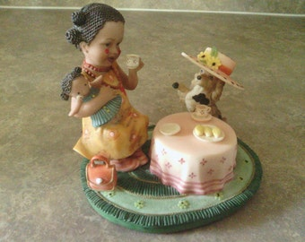 """Very Cute Figurine with a Girl having a Tea Party with her Dog, """"Sweet Memories""""."""
