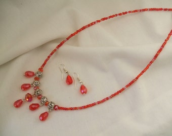 Red chrystal and bead necklace with matching red chrystal earrings.