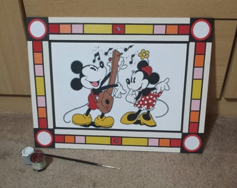 Small wooden mickey and minnie painting