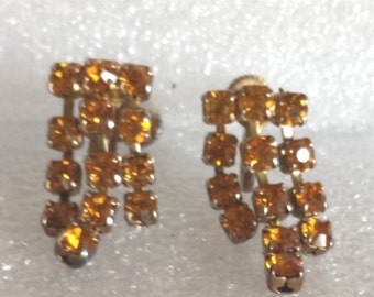 "Vintage citrine rhinestone clip on earrings.  about 1"" l"