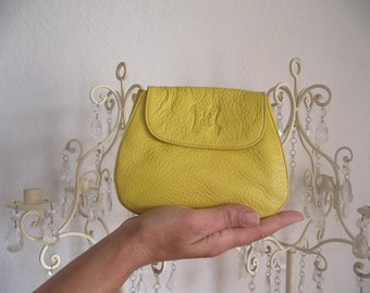 Mini yellow leather pouch.