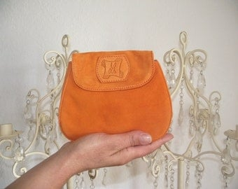 Mini pouch orange leather returned.