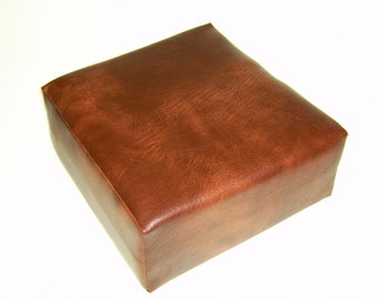 Booster seat cushion made with firm foam and upholstered in chestnut faux leather