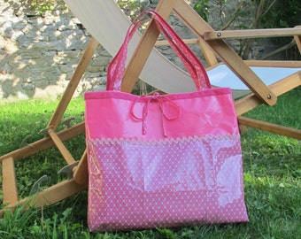 In coated canvas two-tone tote.