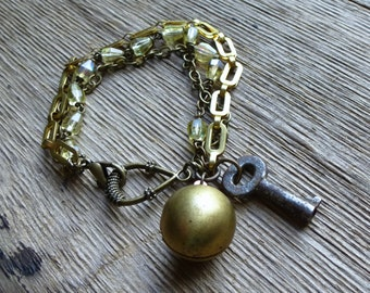 Assemblage Charm Bracelet with Vintage Key, Brass Ball Locket, Recycled Glass Rosary Beads. Eco Chic Jewelry
