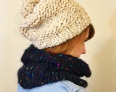 Tan slouchy oversized knit hat with pompom
