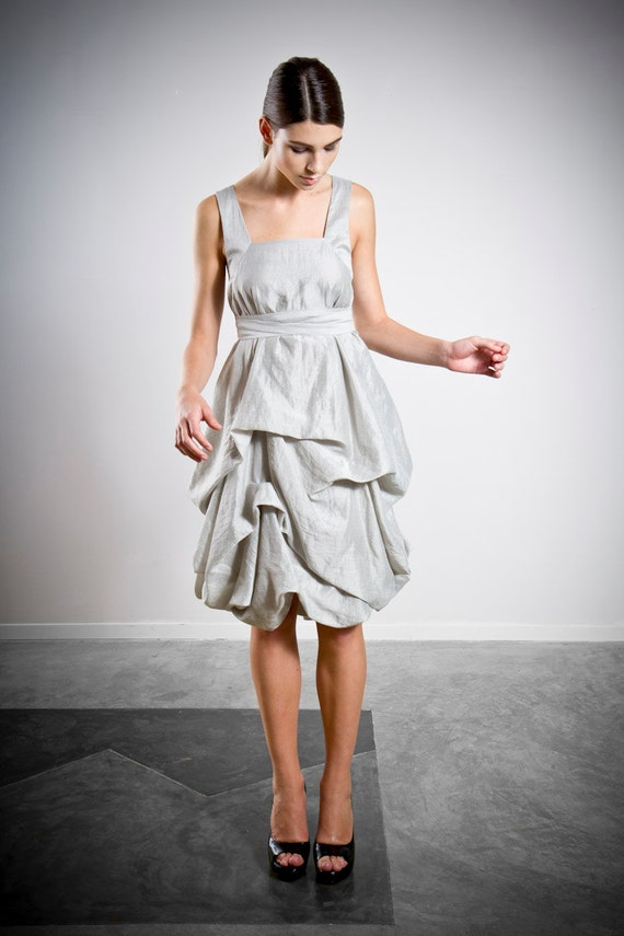 Delphi | by Elika In Love. A silver draped short dress, with bustles and belted waist. Perfect for bridesmaids or as a short wedding dress.