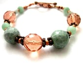https://www.etsy.com/ie/listing/188379712/large-bracelet-aqua-champagne-pink?ref=shop_home_active_23