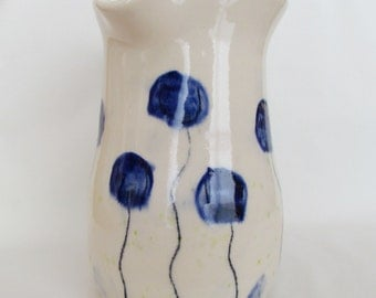 Cobalt Blue and White Flowers Pottery Pitcher
