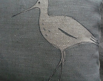 hand printed and stitched  wading bird cushion