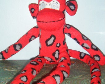 Red Sock Monkey with Black and Gray Spots