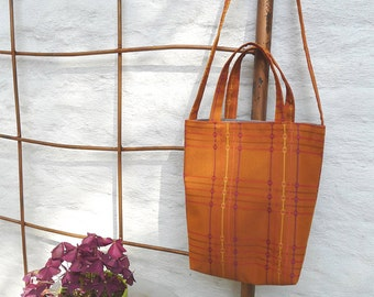 Small tote with shoulder strap, orange plaid
