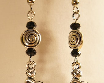 Monkey earrings with black glass beads
