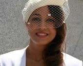 Ivory parasisal bridal headpiece with vintage inspired polka dots veil
