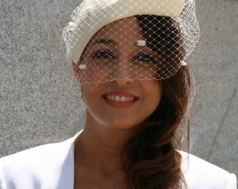 Ivory parasisal bridal headpiece with vintage inspired polka dots veil