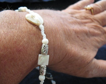 Mother-of-pearls , white glass beads pearls and barrel metal spacers bracelet.