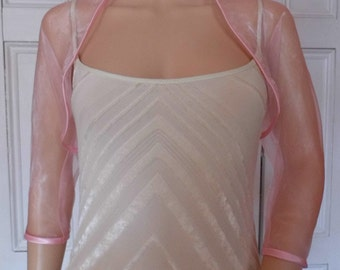 Pale pink organza  three-quarter length sleeved bolero/shrug/jacket  with satin edging